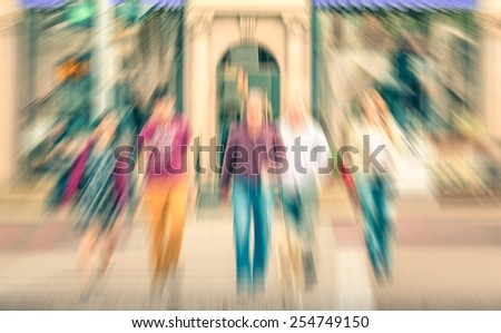 Multiracial people crossing the road near Rodeo Drive and Beverly Hills - Crowded streets of Los Angeles during rush hour in luxury shopping area - Radial zoom defocusing with vintage filtered look - stock photo