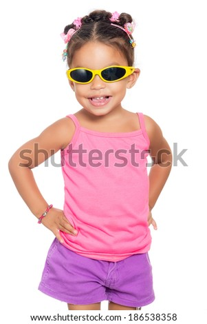 Multiracial small girl  wearing bright  yellow sunglasses isolated on white - stock photo