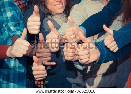 Multiracial Thumbs Up - stock photo