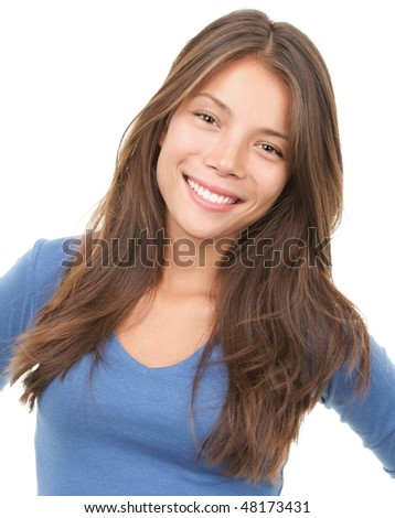 Multiracial woman smiling looking at camera wearing blue shirt. Mixed chinese / caucasian female model isolated on white background. - stock photo