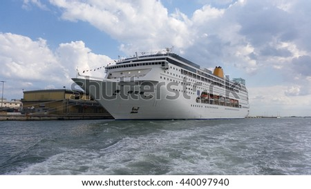 Multistory white passenger ocean ship parked in the dock
