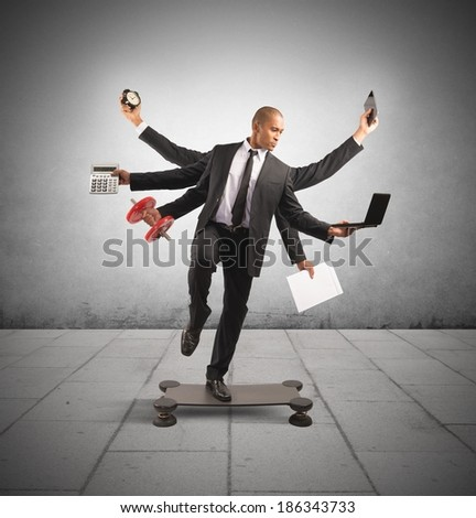 Multitasking concept with businessman at work doing gymnastics