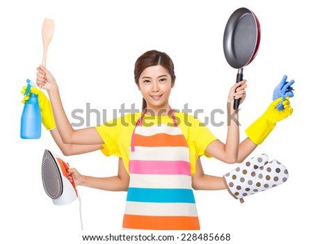 Multitasking housewife - stock photo