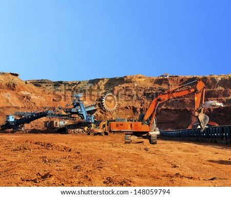 Multiton machinery and Excavators in the open pit mine northern Thailand  - stock photo