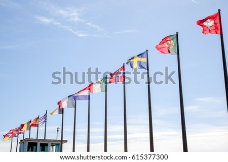 multitude of flag of different countries floats in the wind