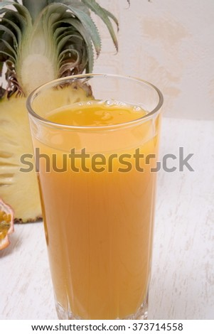 Multivitamin juice and fruits - stock photo