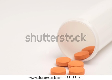 Multivitamins and pill bottle. Selective focusing. - stock photo