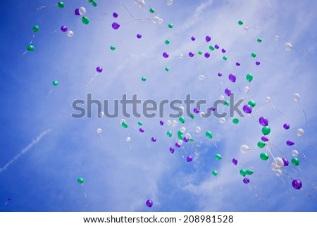 Multscolored balloons flying in sky at the wedding (useful as texture or background). - stock photo