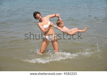 Mum and daughter have a good time in the sea