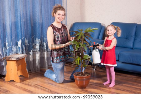 Mum and the daughter look after for a flower - stock photo