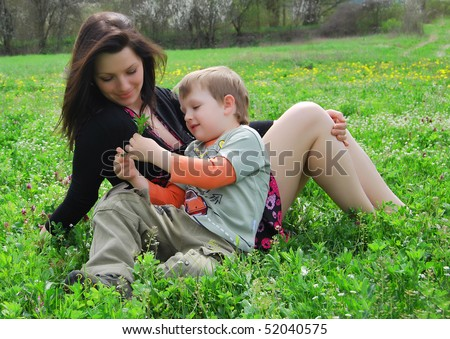 Mum and the son on a walk in a park