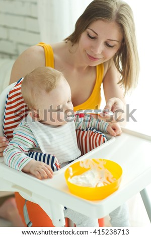 Mum spoon-feeds the child