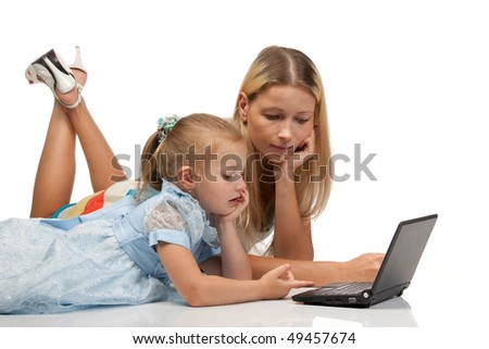 Mum with a daughter lay with the laptop on a white background.