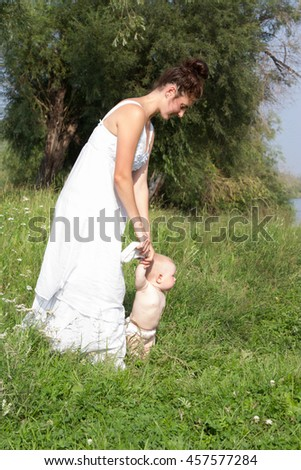 Mum with a small child walking in nature