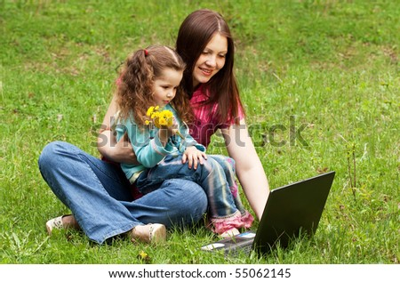 Mum with the daughter on the nature - stock photo