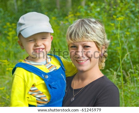 Mum with the laughing child - stock photo