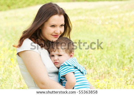 Mum with the son on the nature - stock photo
