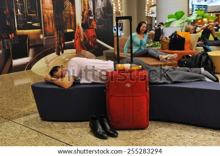 MUMBAI - APR 14: Travellers rest in the transit lounge at the new terminal T2 of Chhatrapati Shivaji International Airport on Apr 14, 2014 in Mumbai, India. The airport first opened in 1942. - stock photo