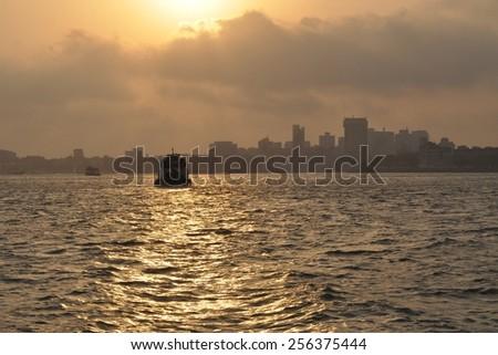 Mumbai harbor with Gate of India and Taj Mahal hotel, India - stock photo