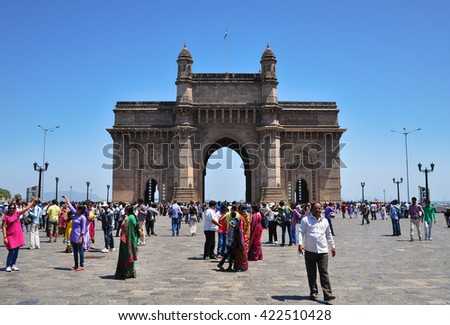 MUMBAI, INDIA - APRIL 13, 2014: Unidentified people by Gateway of India.  The Gateway of India is one of India's most unique landmarks situated in the city of Mumbai. - stock photo