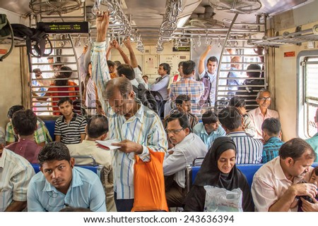 MUMBAI, INDIA - DECEMBER 12, 2012: Unidentified passengers inside Indian Railway local train on December 12, 2012 in Mumbai, India. Indian Railways carries about 7,500 million passengers annually. - stock photo