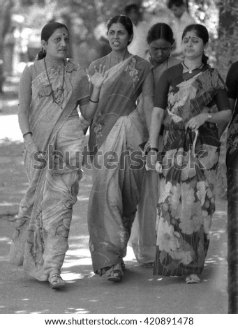 MUMBAI, INDIA - FEBRUARY 15, 1984: four beautiful ladies walking in the street to the biggest open air city market. The place is everyday populated by thousands of people. - stock photo