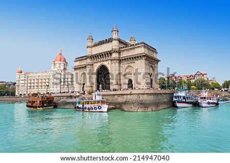 MUMBAI, INDIA - FEBRUARY 21: The Taj Mahal Palace Hotel and Gateway of India on Febuary 21, 2014 in Mumbai, India. - stock photo
