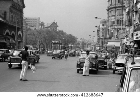 MUMBAI, INDIA - FEBRUARY 15, 1984: traffic and pedestrian in one of the city main street. The place is every day extremely crowded.