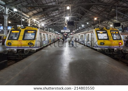 MUMBAI, INDIA - FEBRUARY 21: Unidentified people inside Chhatrapati Shivaji Terminus on Febuary 21, 2014 in Mumbai, India - stock photo