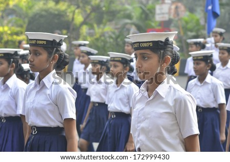 MUMBAI, INDIA - JAN 24, 2014 - Students parading near Marine Drive  during the rehearsal on 24 January 2014 for India's Republic Day to be held on 26 January 2014  - stock photo