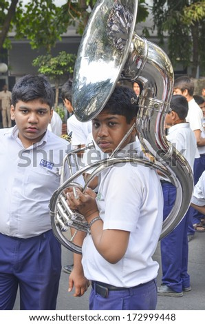 MUMBAI, INDIA - JAN 23, 2014 - Students parading near Marine Drive  during the rehearsal on 23 January 2014 for India's Republic Day to be held on 26 January 2014  - stock photo