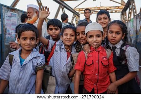 MUMBAI, INDIA - 12 JANUARY 2015: Indian children after school in Dharavi slum - stock photo