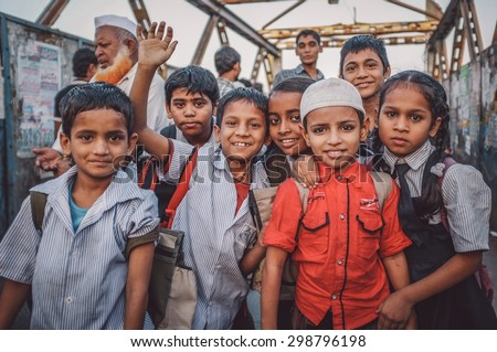 MUMBAI, INDIA - 12 JANUARY 2015: Indian children after school in Dharavi slum. Post-processed with grain, texture and colour effect. - stock photo