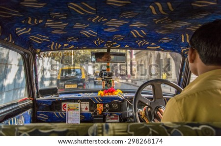 MUMBAI, INDIA - 17 JANUARY 2015: Old taxi's upholstery in Mumbai are decorated Indian style. - stock photo