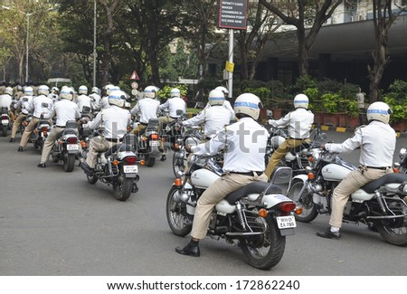 Mumbai, India - January 23, 2014 - Traffic Police riding motorbicycles  parading near Marine Drive  during the rehearsal on 23 January 2014 for India's Republic Day to be held on 26 January 2014  - stock photo