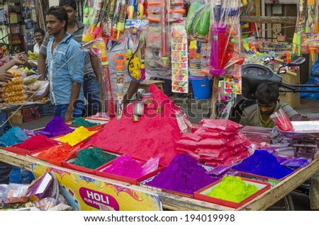 MUMBAI, INDIA - MAR 15, 2014 - Stall selling colorful powder and toys during Holi Festival at local market - stock photo