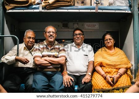 Mumbai, India - March 9 2015: indian passengers posing in the train Goa- Mumbai - Mar, 9, 2015 at Mumbai, India - stock photo