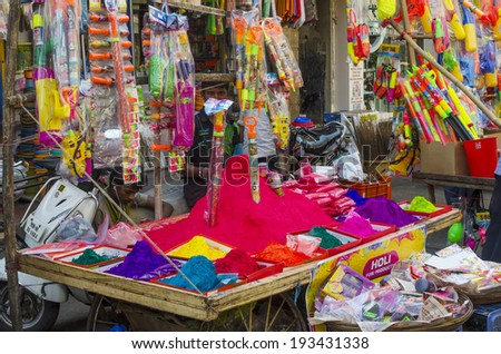 Mumbai, India -  March 15 - Stall selling colorful powder and toys during Holi Festival at local market - stock photo
