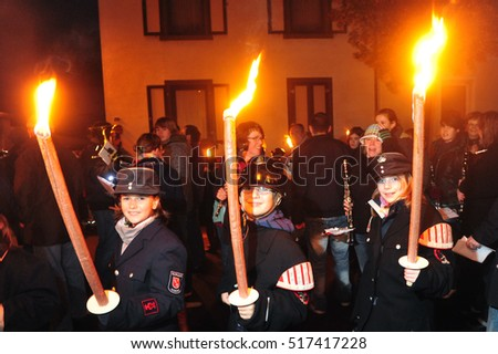 Mumbai, India - November 10, 2009 - Kids on traditional St. Martin parade in Germany with torches and laterns