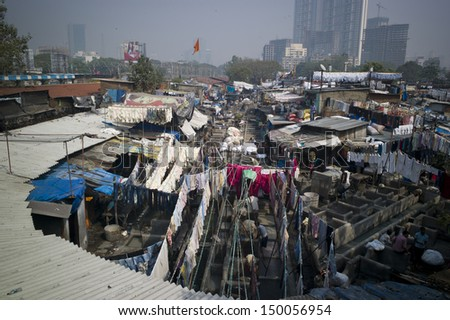 MUMBAI, INDIA - OCT 15: Colorful wet clothes washed by the laundrymen at the Dhobi Ghat on 15 October 2012 in Mumbai. It is the the largest outdoor laundry in the world with 700 washing platforms