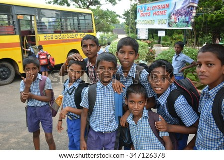 Mumbai, India - October 28, 2015 - Children from children���«s home driving in school bus powered by chartiy project based in Europe - stock photo