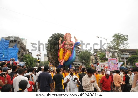 MUMBAI, INDIA - 14 SEPTEMBER 2015 : a group of unidentified faithful people worshiping Hindu God Ganesha by bringing him into the sea at a beachfront Chaupati Beach of south Mumbai.