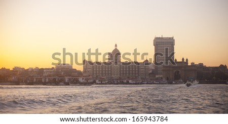 Mumbai India with Gateway and hotel Taj Mahal, sunset - stock photo