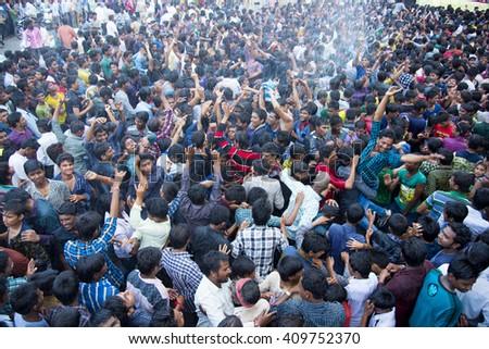 "MUMBAI, MAHARASHTRA, INDIA - SEPTEMBER 06 : Crowd of young People ""Govinda"" enjoying the Dahi Handi festival to celebrate God Krishna's Birth in Mumbai, Maharashtra, India. 06 September 2015"