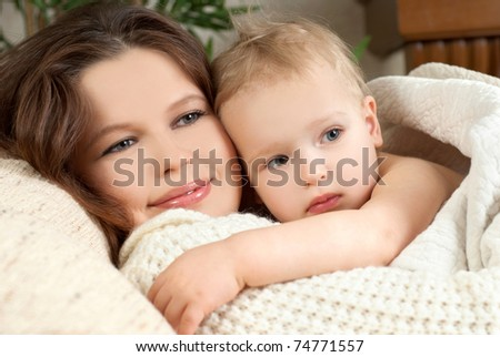 mummy and her kid in  home - stock photo