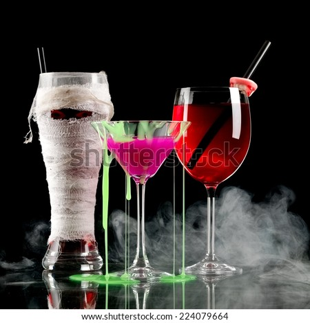 Mummy, pink and bloody Halloween cocktails in smoke - stock photo