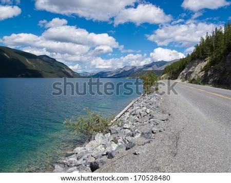 Muncho Lake Provincial Park, Alaska Highway, Alcan, right at the shore of beautiful Muncho Lake, northern British Columbia, Canada - stock photo