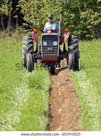 MUNDLEVILLE, CANADA - AUGUST 31: DJ Mundle competes at the 2010 New Brunswick Provincial Plowing Match and Canadian Plowing Championships on August 31, 2010 in Mundleville, Canada. - stock photo