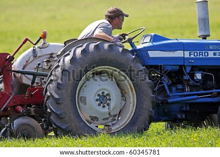 MUNDLEVILLE, CANADA - AUGUST 31: Troy Gray concentrates on his line at the 2010 New Brunswick Provincial Plowing Match and Canadian Plowing Championships on August 31, 2010 in Mundleville, Canada. - stock photo