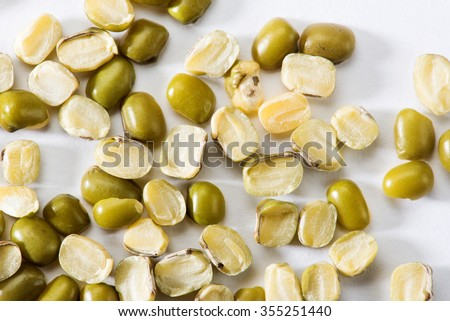 Mung bean split Pulse unpolished with cover isolated on white background - stock photo